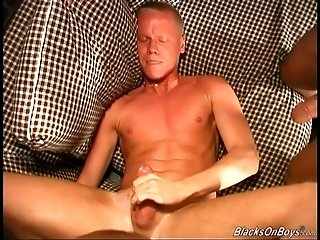 Blonde twink Mark gets his mouth and ass fucked by two black studs