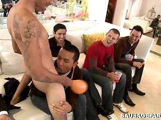 A few horny queers give blowjob to a handsome dude at a party