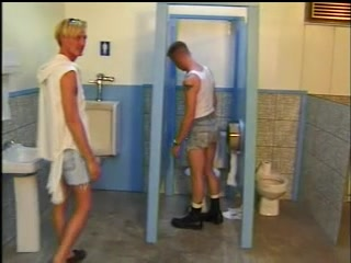 Blond homo gets his mouth and butt fucked through a gloryhole